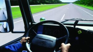 Carolina Truck Insurance customer motoring down the interstate properly insured with filings done.